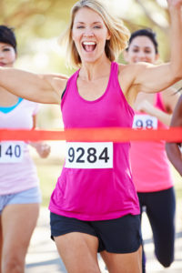 Female Runner Winning Marathon