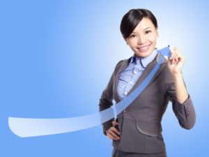 17078945 - success business woman draw arrow with blue background, asian model
