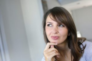 15849294 - attractive brunette woman with doubtful look