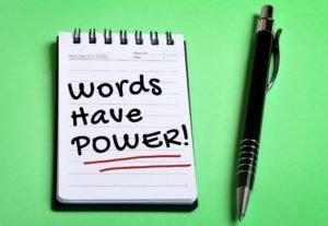 40516957 - words have power word on notebook page