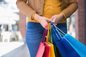 45535742 - woman holding shopping bags at a boutique